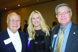 From left: former Urbandale Mayor Don Brush, Lori Gelhaar with the Palmer Group, and Urbandale City Councilman David Russell at the Urbandale Chamber of Commerce's annual meeting.